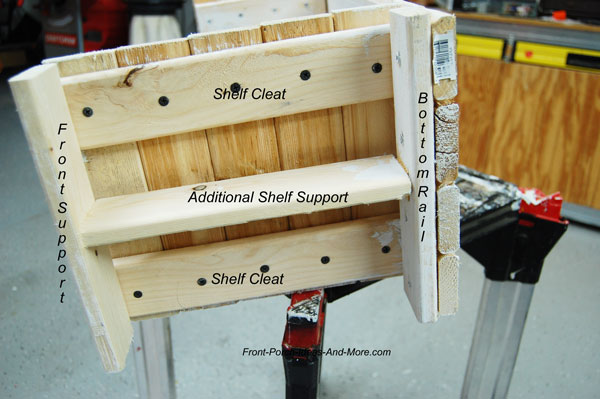 view of wood supports on bottom of candy holder