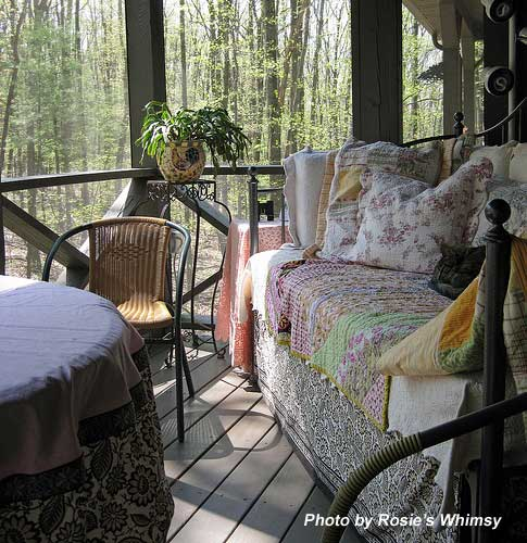 A sleeping porch covered by a lovely quilt