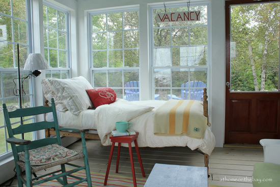 sleeping porch with bed and comfortable furniture