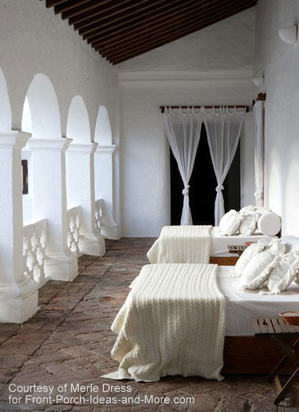 A comfortable sleeping porch with two lovely beds