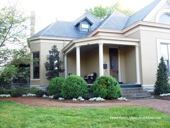 small front porch with flat roof