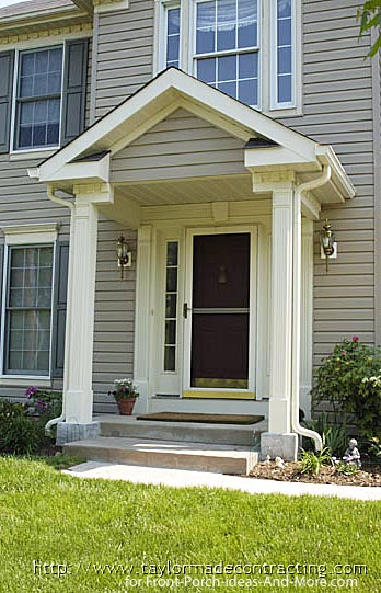 small front porch with round columns and dentil moldings