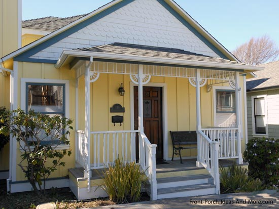 Unique yellow porch with a hip roof design