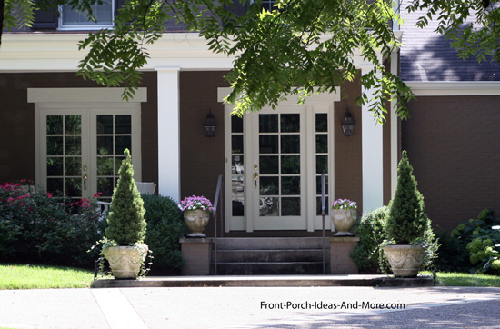 Unique tiny front porch with chippendale balustrade