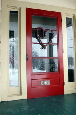 Heart-shaped wreath on the front door