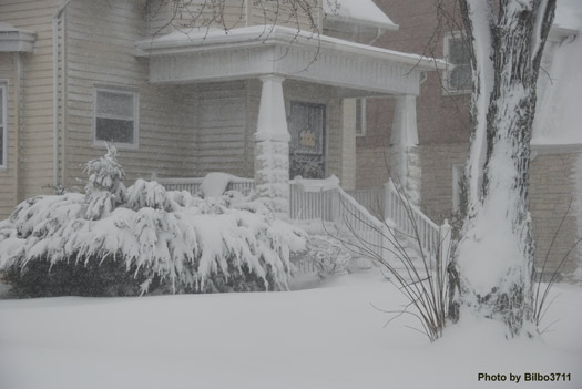 Snowy winter scene of home in neighborhood