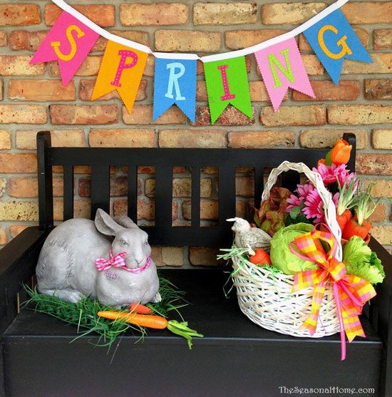 Eileen's decorates her porch bench with an Easter bunny and basket - and look at that spring banner!
