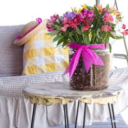 porch decorated for spring with flowers