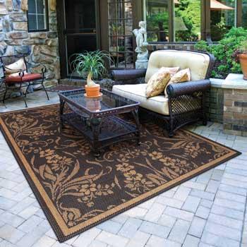 an indoor outdoor rug in sunroom