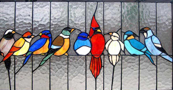 stained glass panel with a variety of birds