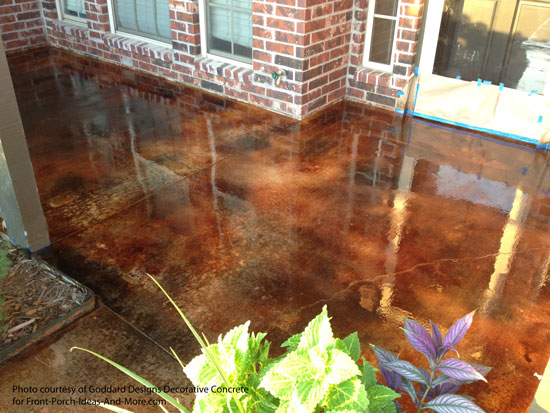umber and black stained concrete on patio