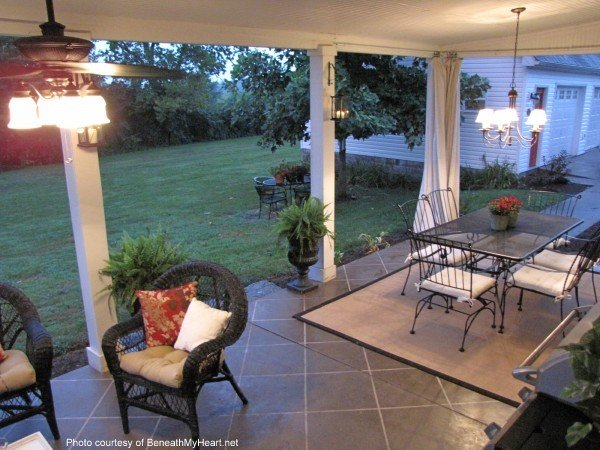 covered patio with furniture and stained concrete floor