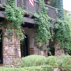 beautiful stone porch columns with ivy