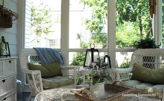 screen porch with wicker furniture