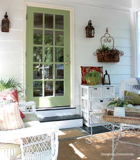 screen porch with nicely painted door