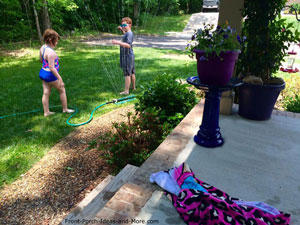 Grandchildren enjoying the sprinkler on a hot summer day