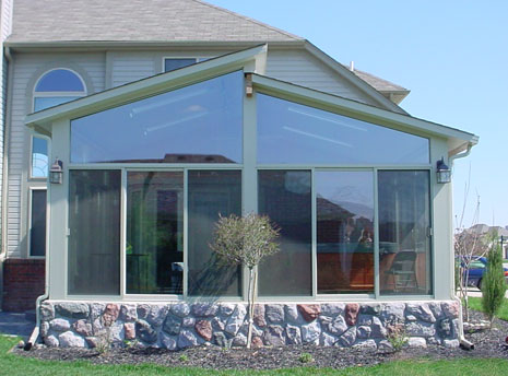 Split Sunroom Roof with stone skirting