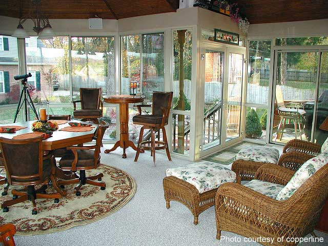 cozy furnished sunroom with tongue and groove ceiling