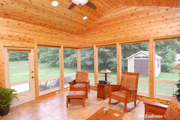 sunroom with windows from DIY EzeBreeze and tongue and groove ceiling
