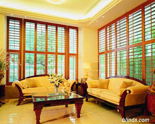 plantation shutters on sunroom windows