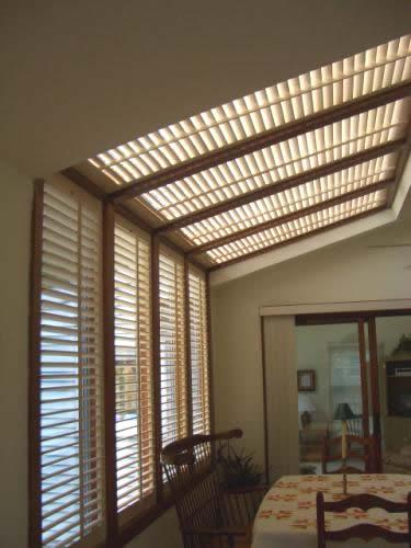 plantation shutters on sunroom skylights