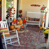 wonderfully decorated front porch for fall