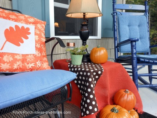 Dress up your Thanksgiving porch with side tables, lamps and cozy fabrics