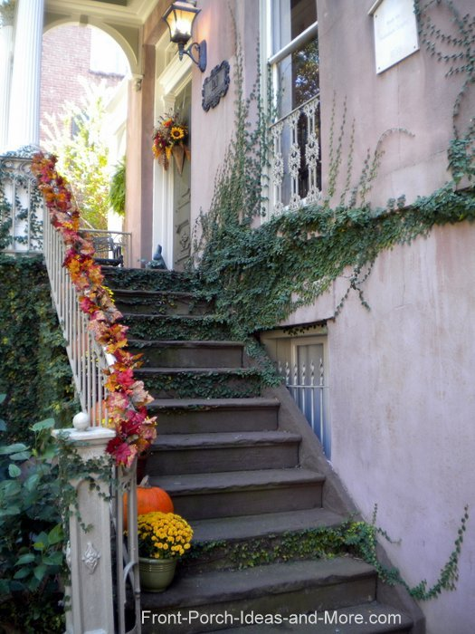 Elegant leaf garland trailing down a porch staircase