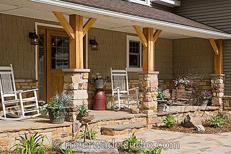 country style log porch with rocking chairs  - photo courtesy of Roger Wade Studios