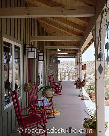 log porch with red rocking chairs - photo courtesy of Roger Wade Studios