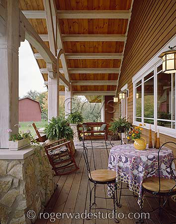 log porch with dining area  - photo courtesy of Roger Wade Studios