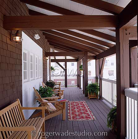 beautiful log porch with wood seating  - photo courtesy of Roger Wade Studios