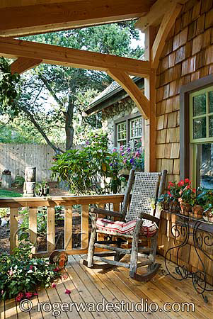 Exposed beams on ceiling of this timber frame porch