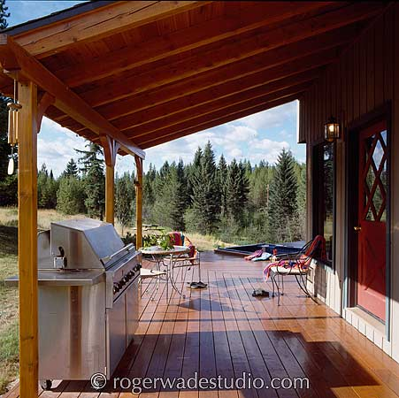 large cooking area on this log porch  - photo courtesy of Roger Wade Studios