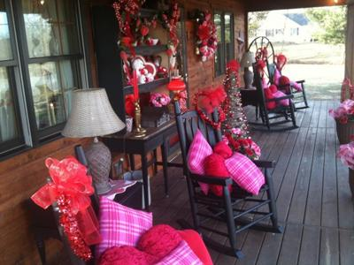 colorful display of valentine decorations on front porch