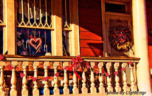 valentine garland on front porch railings