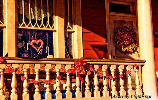 valentine garland on front porch railings