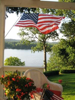 View from Marcias Porch is stunning with a gorgeous lake and waving flag