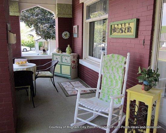 vintage brick porch with bistro table