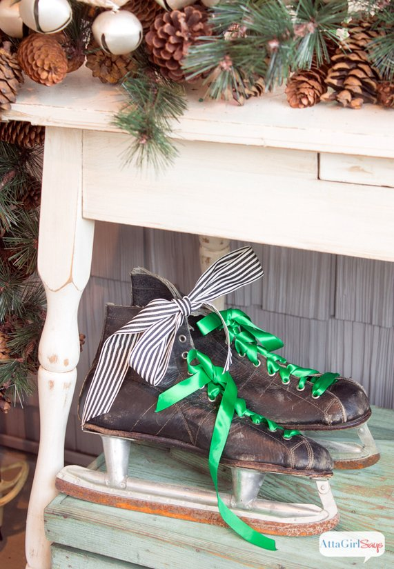 Vintage ice skates tied with pretty Christmas ribbons - Atta Girl Says front porch