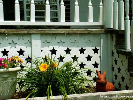 Custom vinyl lattice panels with star design on porch skirting