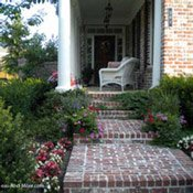 fanciful brick sidewalk leading to front porch