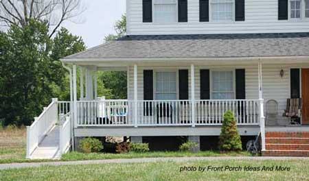 wheelchair ramp on large farmhouse wraparound porch