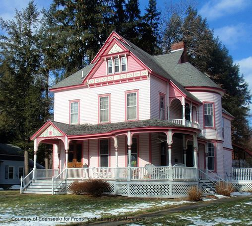 Beautiful pink Victorian home in the snow