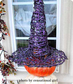 witch hat on pumpkin for Halloween on front porch