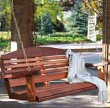 A wooden porch swing