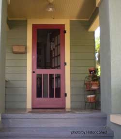 red wood screen door on front porch