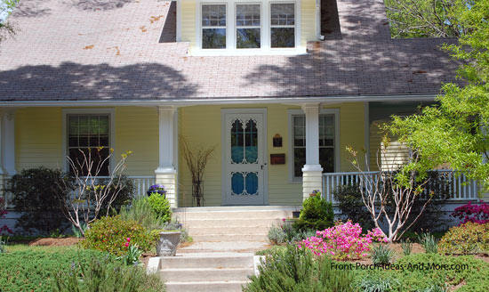 large yellow home and wrap around porch