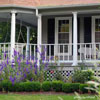front porch steps, walkway, and garden landscaping