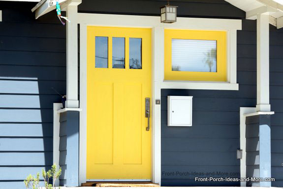 yellow front door on porch
